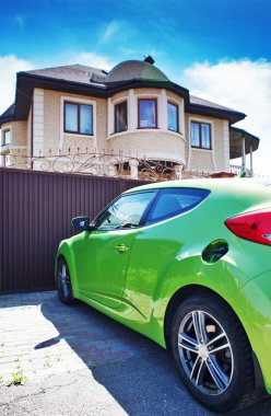 Luxury sport car in front of a house