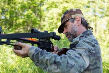 Hunter shoots a crossbow