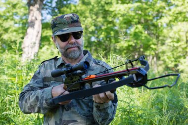 Hunter holding a crossbow