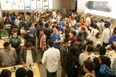 Buyers and sellers in the Apple store in Hong Kong.