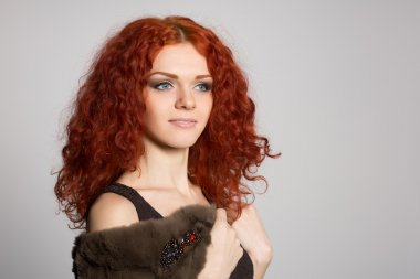 Portrait young woman with red hair