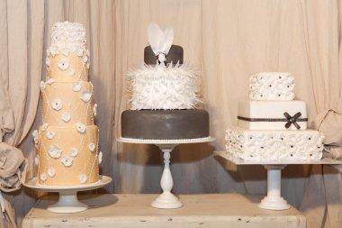 Three elegant wedding cakes