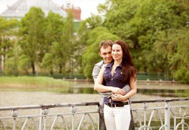 Young couple walking on bridge