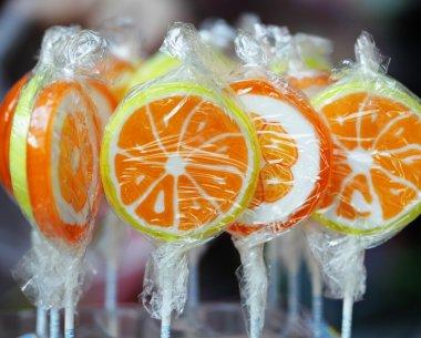 Orange lollipops