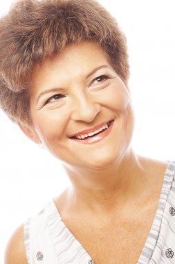 Close-up of a mature woman smiling. Isolated on white. stock vector