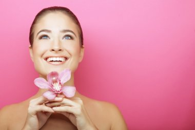 Happy woman with orchid flower