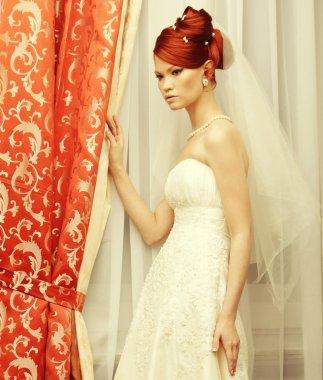 Happy bride posing in hotel room