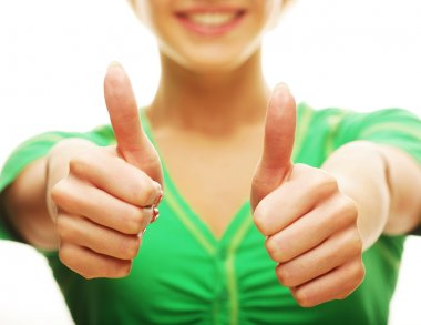 Portrait of a happy casual girl showing thumbs up and smiling, against white background stock vector