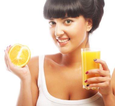 brunette woman holding orange juice