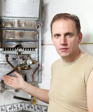 The man thinks of repair of a gas water heate