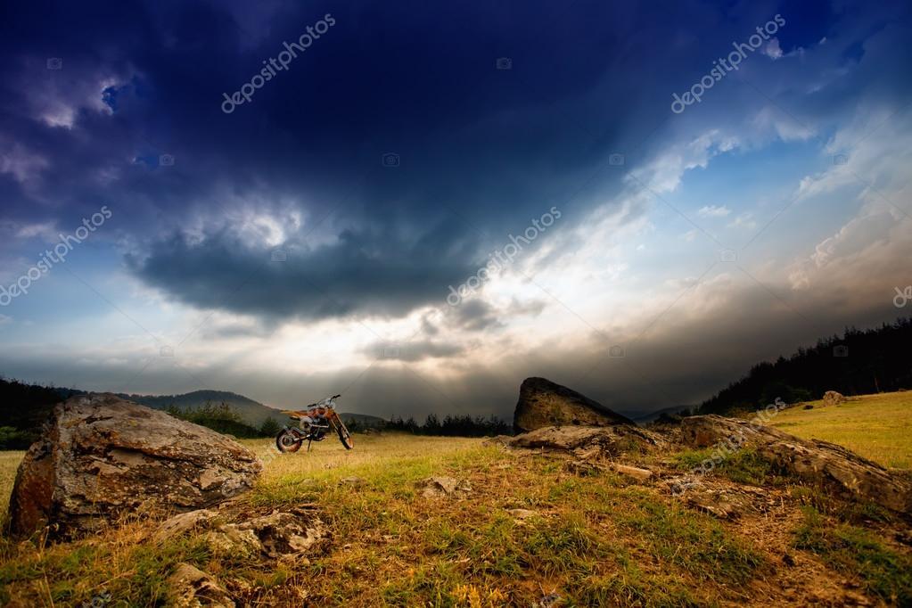 sunset landscape with dirt bike