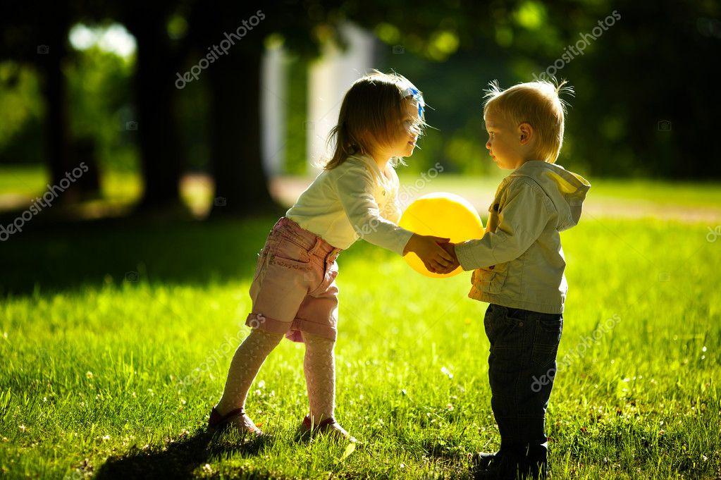 boy and girl playing with ball