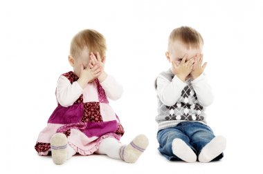 Little boy and girl covers his face