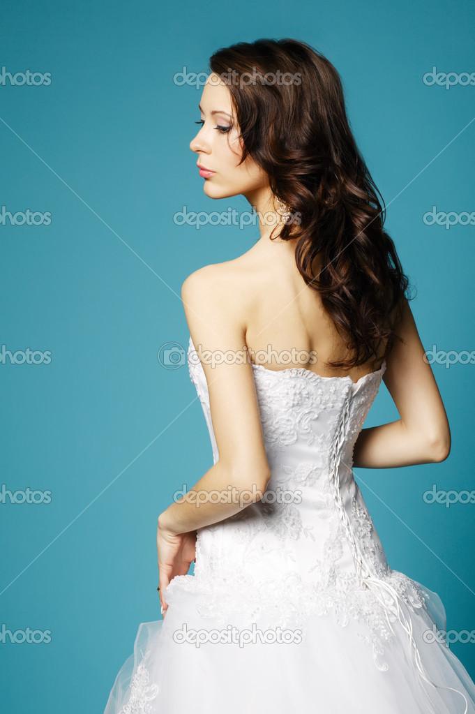 beautiful girl in wedding dress on blue background — Stock Photo ...
