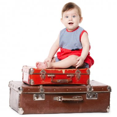 baby with suitcase isolated on white