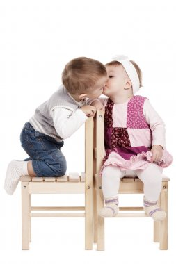 Little cute boy kissing a girl