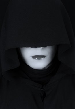 Woman in black cape with sad face artistic conversion