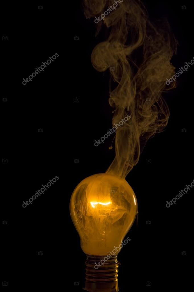 Broken light bulb burn out with flame — Stock Photo