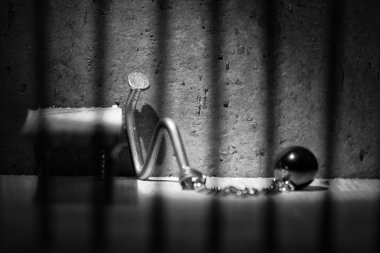 Conceptual jail photo with iron nail ball and chain artistic con