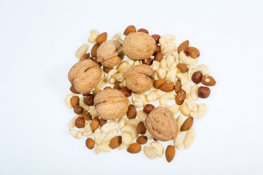 Mixed nuts  -  hazelnuts, walnuts, cashews,  pine nuts isolated on white background