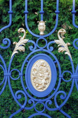 Forged gates with leaves and gilding