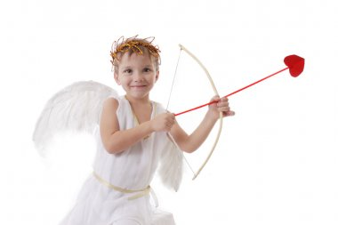 Smiling cupid boy aiming arrow
