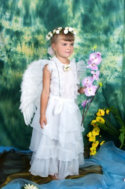 Cheerful girl with angel wings with pink orchids