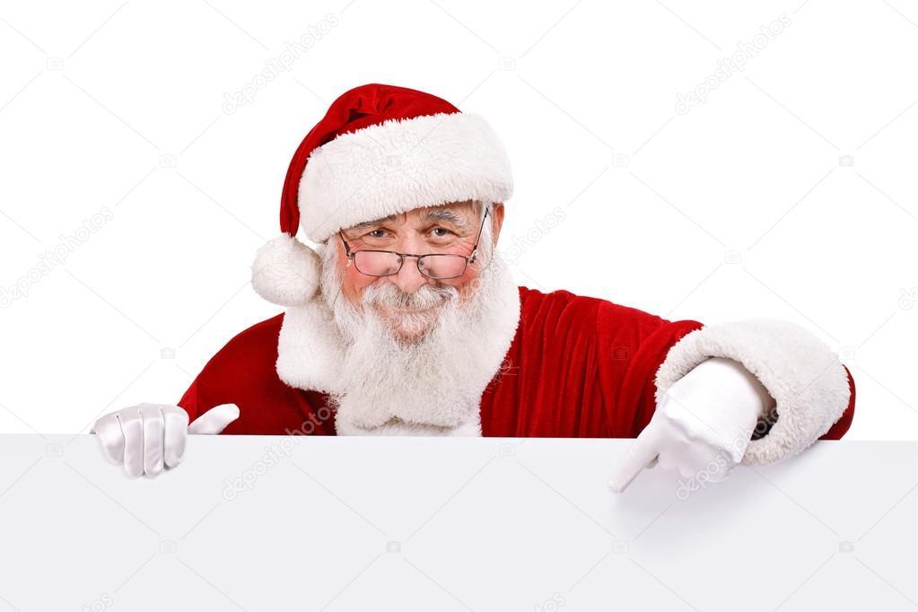 Santa pointing in white sign