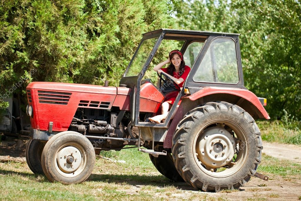 Young country girl on tractor