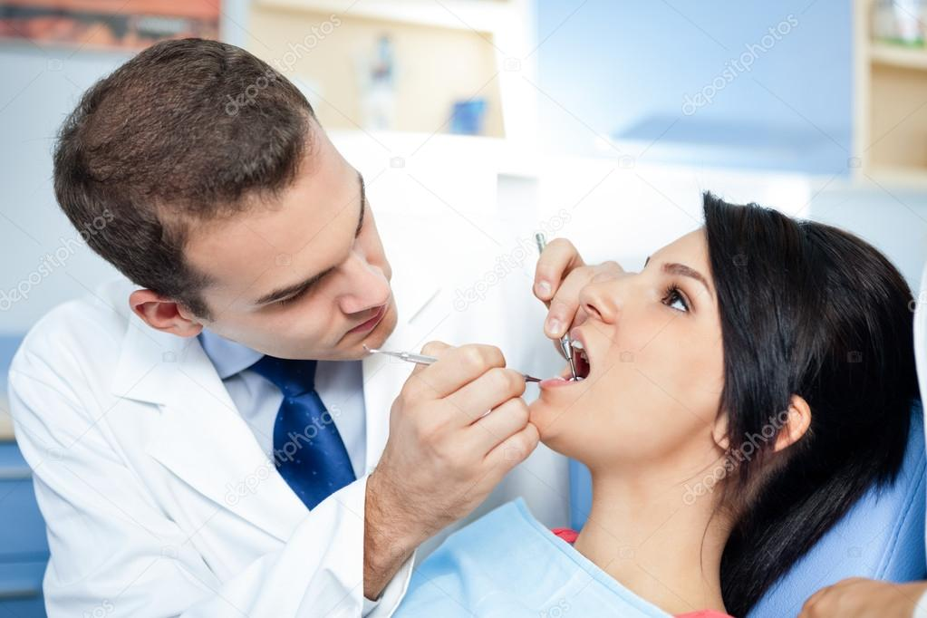 dentists assistant preparing patient