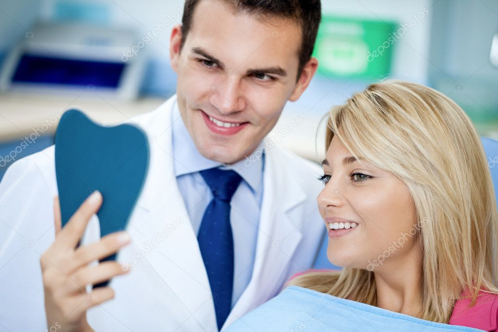 Dentist and satisfied patient with white teeth