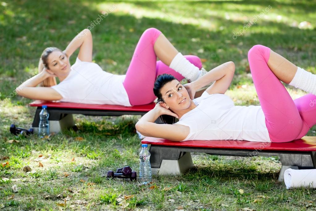 Women exercise in park