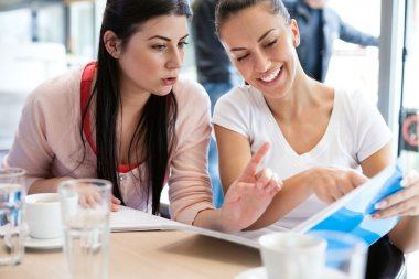 Teenage students studying together