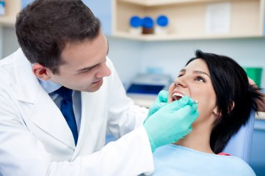 Dentist working on patient's teeth