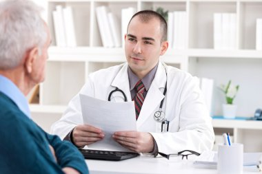 doctor talking with senior patient