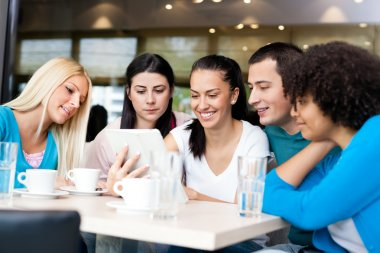 Group of young in modern cafe