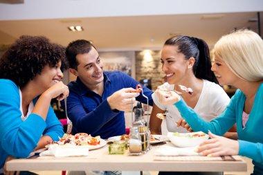 Happy teenagers having lunch