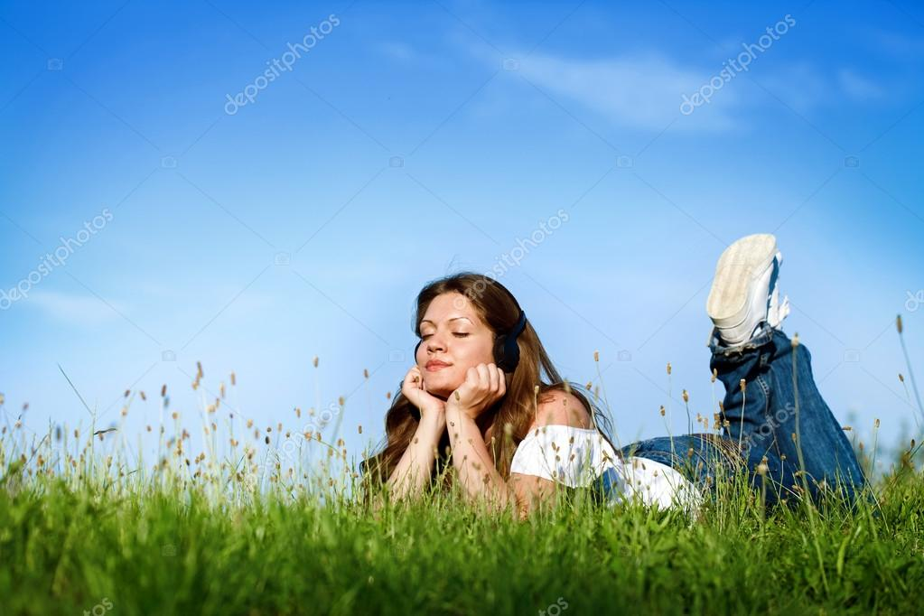 Young girl relaxing and listening music