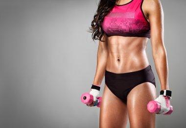 Fit woman lifting dumbbells
