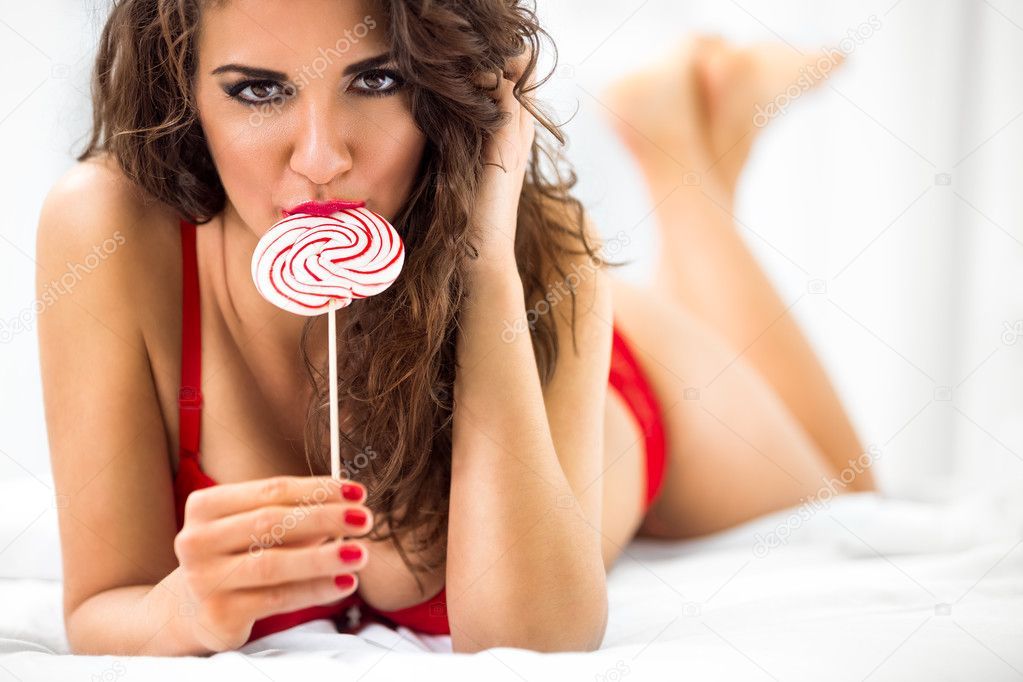 Sexy lady licking a lollipop