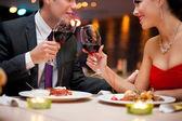 Fotografie Couple toasting wine glasses