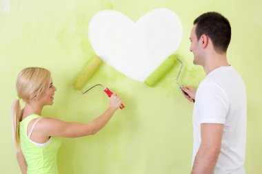 Couple at heart painting on wall