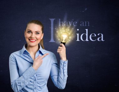 Woman holding bright bulb