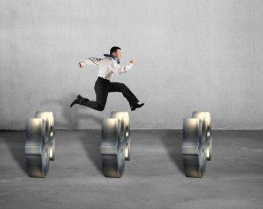 Businessman jumping over USD symbols