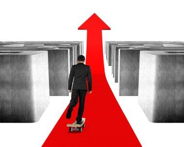 Businessman skateboarding through maze on red arrow