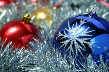 Three christmas glass spheres and a tinsel