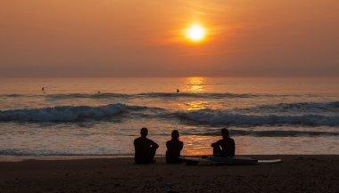 Surfers Admiring the Sunset