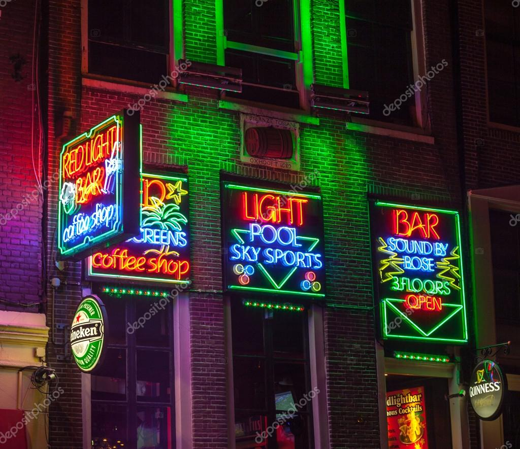 Red light bar in amsterdam stock editorial photo razvanphoto amsterdamnetherlands october 31st 2011 night image of colorful coffee shop signs in the red district from amsterdam photo by razvanphoto aloadofball Gallery