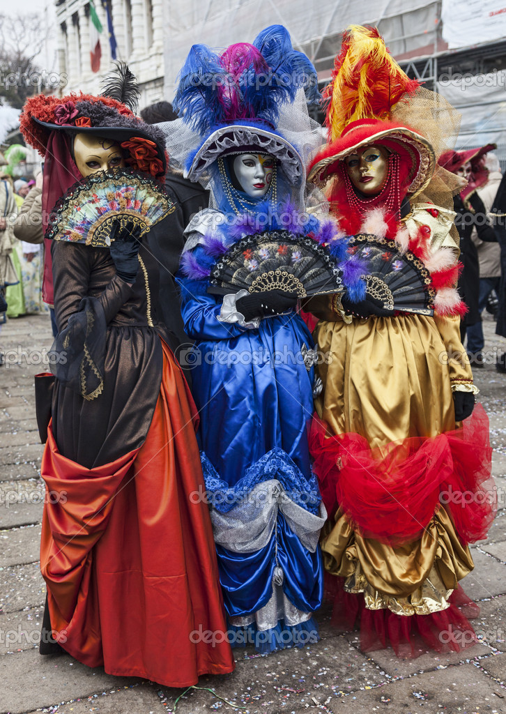 efd4f5754e61 Venice Italy- February 18th 2012 Image Of A Group Of Three Persons Wearing  Colorful Costumes And Masks In San Marco Square In Venice During The  Carnival .