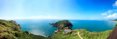 Tropical panorama landscape and seascape view from a hillside